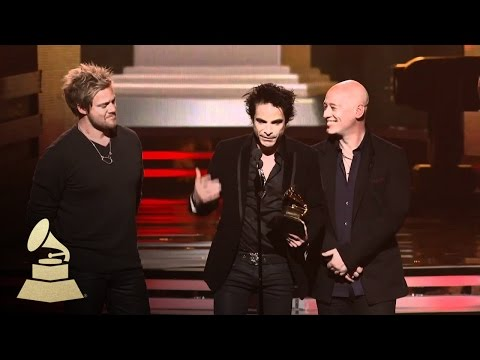 Train accepting the GRAMMY for Best Pop Duo or Group at the 53rd GRAMMY Awards | GRAMMYs
