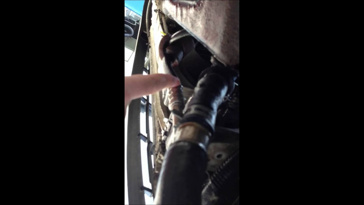 Fixing leaking transmission cooler line on 2002 Ford ...