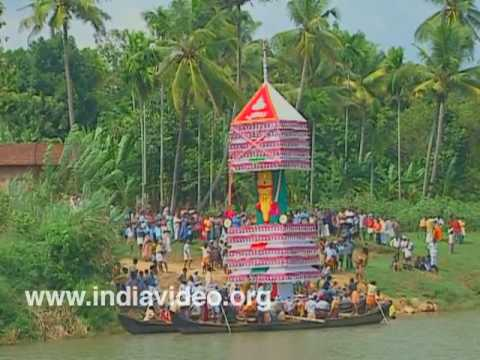 Chamakkavu kettu kazhcha - effigy being taken to the temple on a country boat