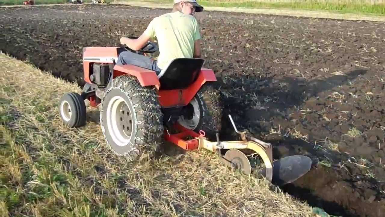 Case 448 Garden Tractor pulling a 10 Brinly Moldboard plow YouTube