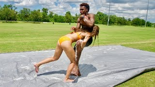 I GOT RAN OVER BY A GIRL! SLIP AND SLIDE TACKLE FOOTBALL vs MY GF #2