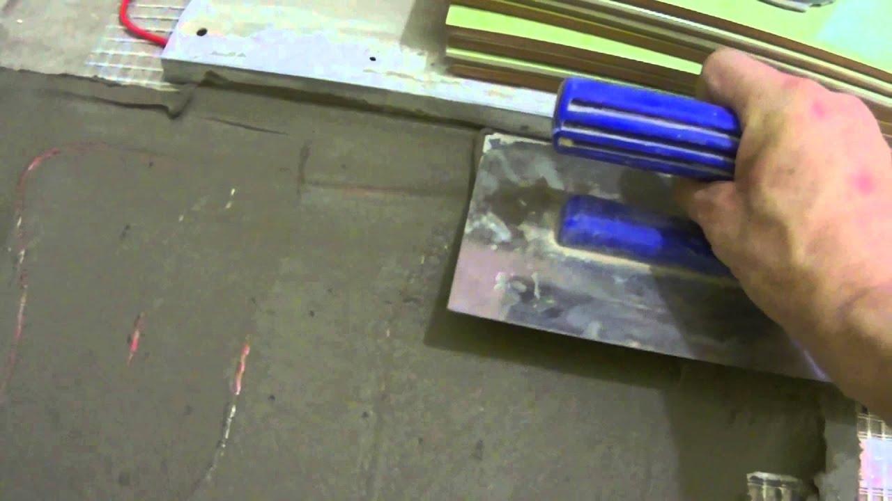 Укладка напольной плитки на тёплый пол