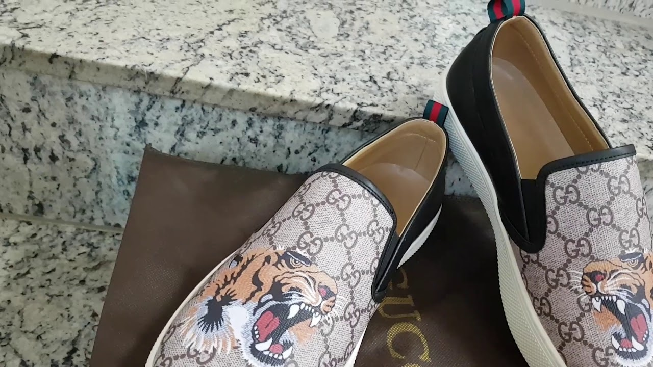 57c38e95a8427b Tênis Gucci Tiger Slip on Unissex - YouTube