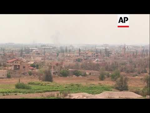 Smoke rises above Douma after Russia says Syrian government in control