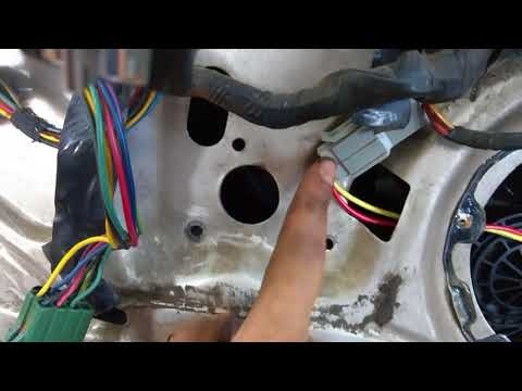 How to Replace Front Door Window Motor in a 1981-1989 Lincoln Town Car