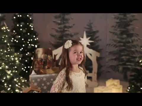 A little girl sings silent night holy night