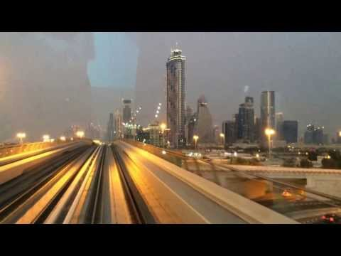 Dubai Metro red line driver's view with lit Burj Khalifa (at dawn)