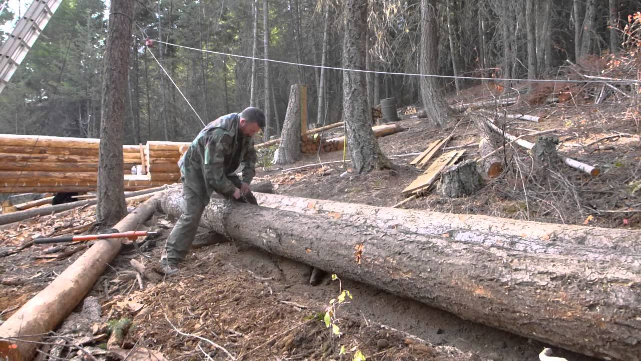 Off grid log cabin build moving logs youtube for Off grid cabin foundation