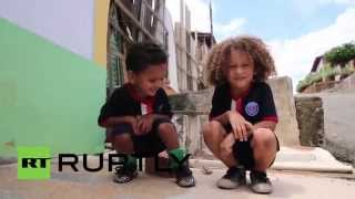 Baixar Brazil: Meet the 'mini clones' of football stars David Luiz and Thiago Silva