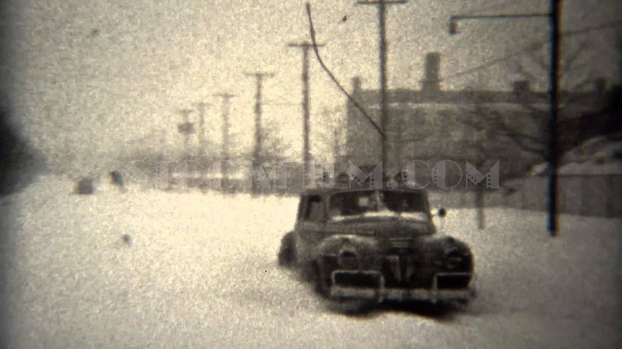 1944: Cars driving unplowed winter snow covered streets sliding ...