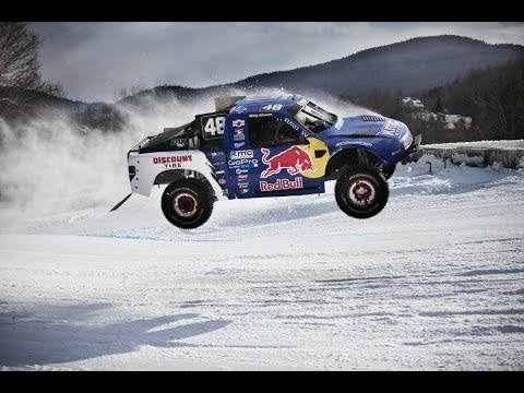 Head-to-head off-road truck race on snow - Red Bull Frozen Rush