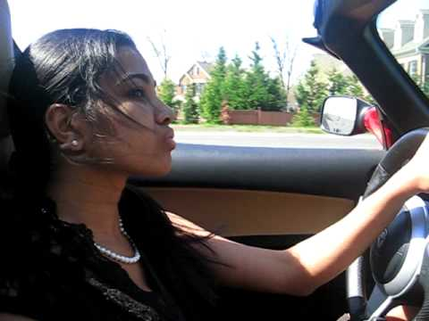 Maddy, co-founder of Renew America Roadtrip test drives the Tesla Roadster in Virginia