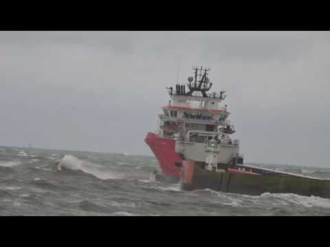 North Sea Oil Supply vessel (E R Athina) leaving Aberdeen Harbour in heavy swell
