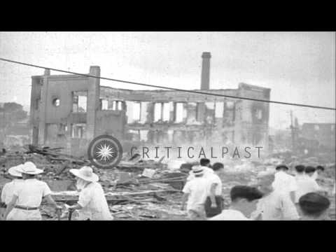 Fires burning and ruins of a city during the Indochina War. HD Stock Footage