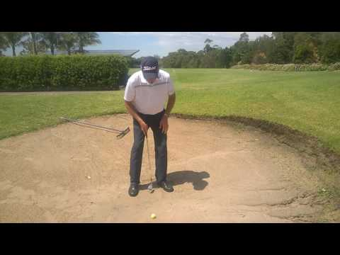 Peter Johnston playing bunker shot from compact lie