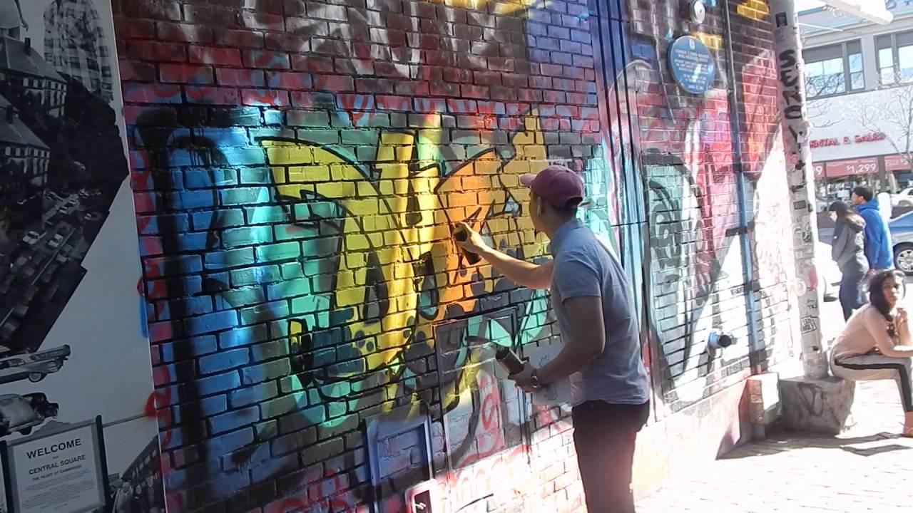 Graffiti wall cambridge ma - Dominick Zheng Painting Graffiti Mural In Central Square Cambridge