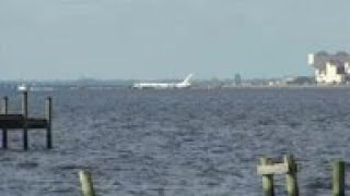 Charter plane in Florida river at end of runway