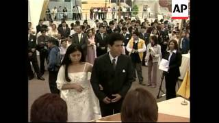 Fifty couples tie the knot in mass wedding in Lima