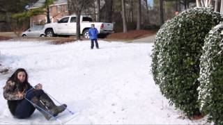 Macon snow: Riding a sled down the driveway slope
