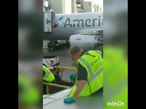 Unsafe American Airline airplane about to take off Place people read into the end
