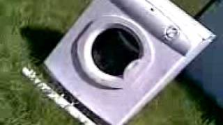 Guy in tumble dryer smashed by sledge hammer weilding maniac