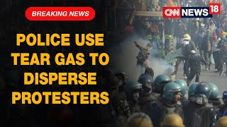Police Use Tear Gas To Disperse Farmers Attempting To Break Barricades At Ghazipur bBorder