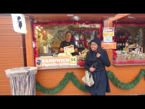 Eating Corsican figatellu sausage sandwiches at Marseille Christmas market