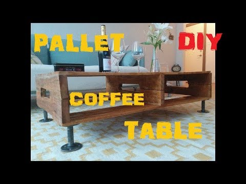 DIY  Transform Pallet into a  coffee table with black pipe and flanges legs.