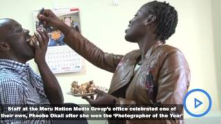 Staff at the Meru NMG office celebrated after Phoebe Okall won the 'Photographer of the Year'