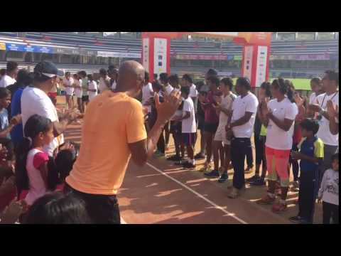 Fusionathletica.Com Unnathi Aiyappa doing long jump and legend Mike Powell appreciating