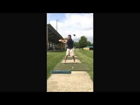 Female junior golfer after practicing with the Straight Arm.  Straightarm.net.