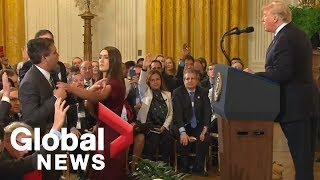 White House aide grabs mic from CNN\'s Acosta during heated exchange with Trump