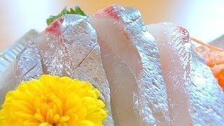 Eating Japanese food Sashimi