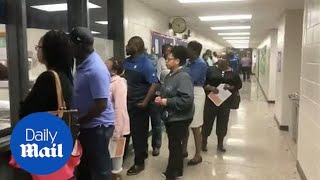 Voters in Georgia wait hours to vote in midterm elections