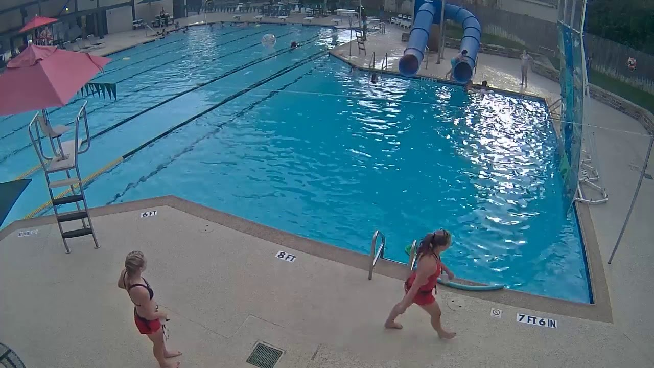 4709456956bf CAUGHT ON CAMERA  Lifeguard Saves Young Girl from Drowning in Neighborhood Swimming  Pool