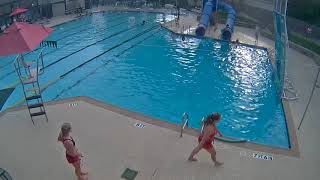 CAUGHT ON CAMERA: Lifeguard Saves Young Girl from Drowning in Neighborhood Swimming Pool