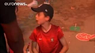 EURO2016  Portuguese KID comforts French FAN