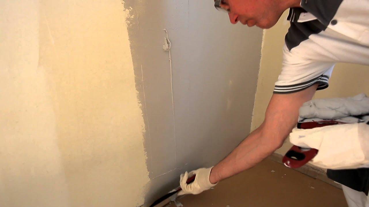 slibe pudset væg