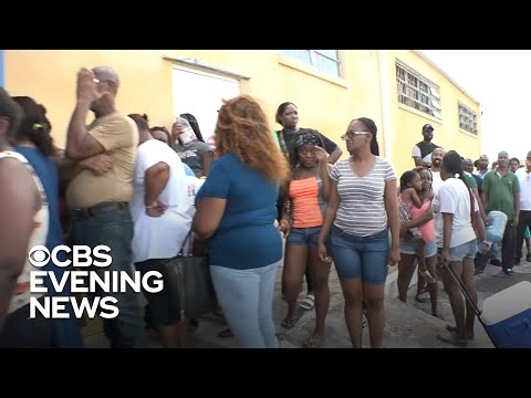 Residents wait in long lines for water on Grand Bahama island