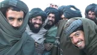 Talibans seeing themselves filmed for the first time - 2001