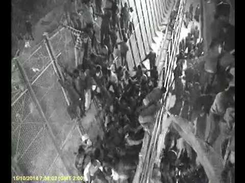 CCTV Black African MIgrants Melilla Spain Breaing Fence