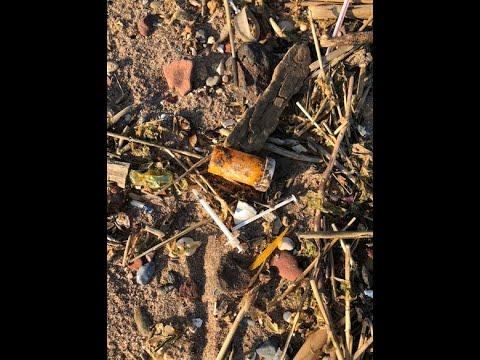 Watch: 'Dark Guardian' removes hypodermic needles from Staten Island beach