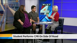 Student performs CPR on the side of the road