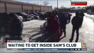Shoppers wait in line for deals at closing Sam's Club