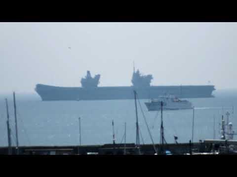 Scillonian III slips back into Penzance past HMS Queen Elizabeth