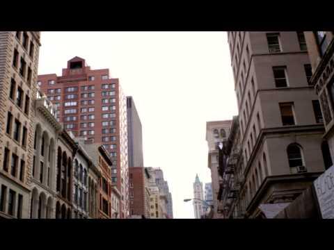 Slow panning shot of older buildings in NYC.