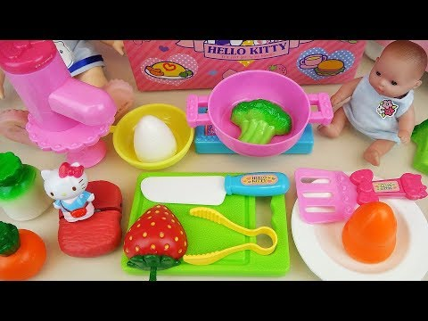 Hello Kitty kitchen and baby doll cooking...