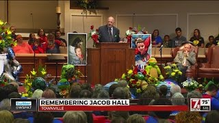 Superhero funeral honors 6-year-old fatally shot at school