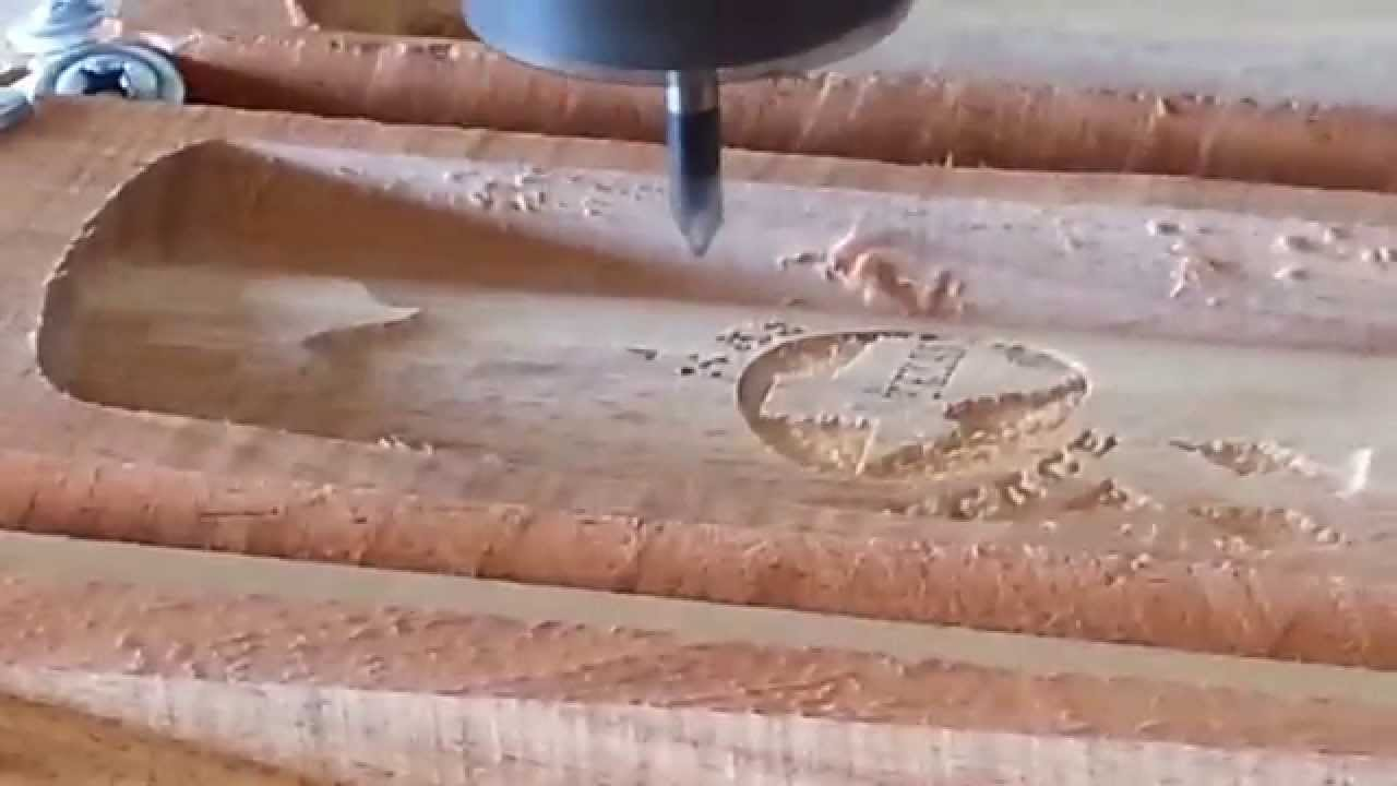 Engraving on some mesquite gun grips - YouTube