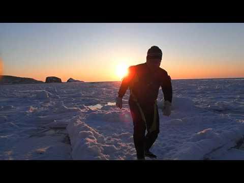 流氷に沈む夕陽@知床流氷ツアー